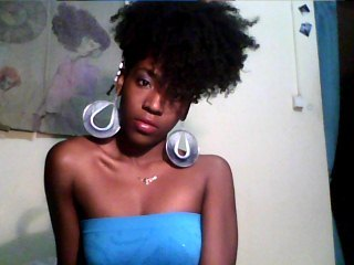 Rock that puff - Medium hair styles, Readers, Female, Black hair, Adult hair, Afro puff, Curly kinky hair, 2010 Holiday Photos Hairstyle Picture